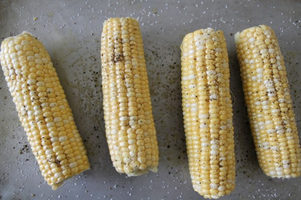 Rub each ear of corn with olive oil. Sprinkle with salt and pepper. Roast in a preheated 425 degree oven for about 45 minutes. Rotate ears for even roasting.