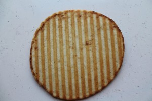 Brush pita with reserved garlic oil and grill. I used a panini press. A non-stick skillet would also work.