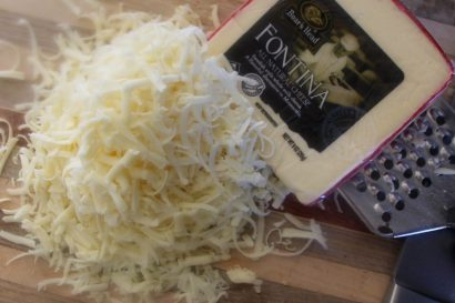 Fontina is a semi-hard cheese with mild, nutty flavor. It melts beautifully.